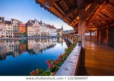 Bord de l'eau aube vue ville central Suisse Photo stock © xbrchx