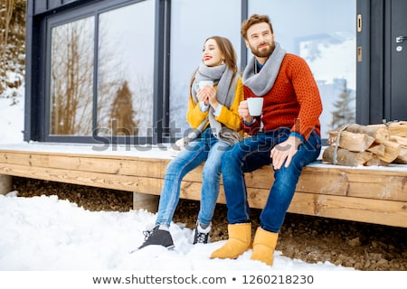 Cheerful young couple dressed in winter clothing Stock photo © deandrobot