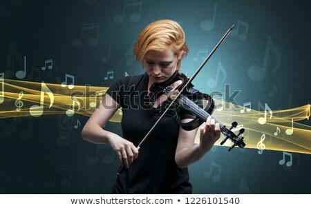 Zenész játszik cselló jegyzetek körül fiatal Stock fotó © ra2studio