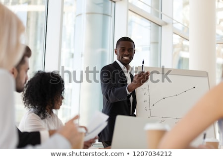 Man Make Presentation on Conference for Coworkers Stock photo © robuart