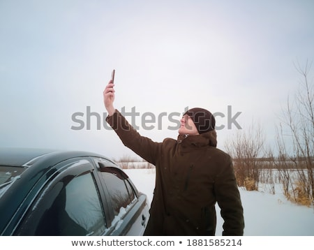 Young man trying catches car Stock photo © jossdiim