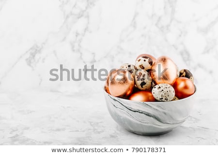 Quail eggs on grey  background stock photo © furmanphoto