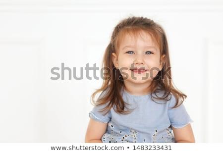 Bonitinho pequeno menina olhos azuis brim jeans Foto stock © dashapetrenko