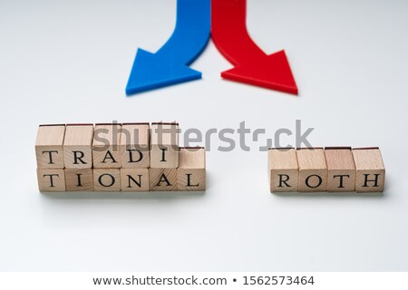 Directional Arrows Showing Ira Options On Blocks Over Desk Stock photo © AndreyPopov