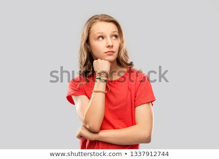 teenage girl in red t-shirt with bangles on arm Stock photo © dolgachov