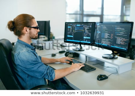 Programmer Typing Code on desktop computer, Developing programmi Stock photo © snowing