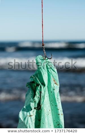 Gebruikt plastic zak vis haak Stockfoto © nito