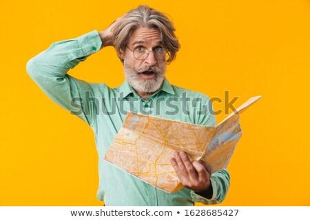 Verwechselt Mann halten Karte Bild posiert Stock foto © deandrobot