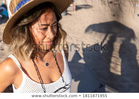 Beach summer vacation lifestyle young Asian woman relaxing sun tan on Hawaii beach. Happy smiling Ch Stock photo © Maridav