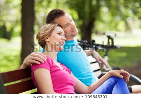 Couple sitting by their bikes in the countryside Stock photo © photography33
