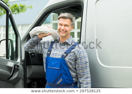 man carrying coil stock photo © photography33