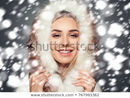 Woman in a furry hood Stock photo © photography33