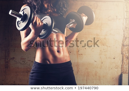 Close-up of woman holding gym weight stock photo © photography33