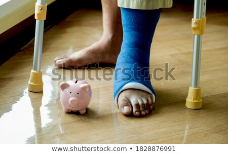 Plasterer holding piggy-bank Stock photo © photography33