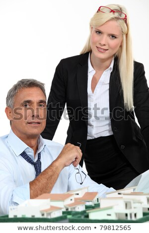 architect and his assistant with plans and a 3d model stock photo © photography33