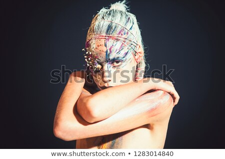 Dramatic style. Artistic woman with painted face posing Stock photo © gromovataya