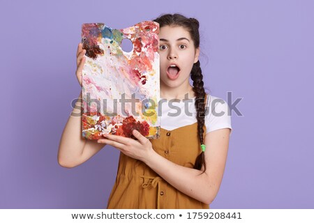 Painter posing with her supplies Stock photo © photography33