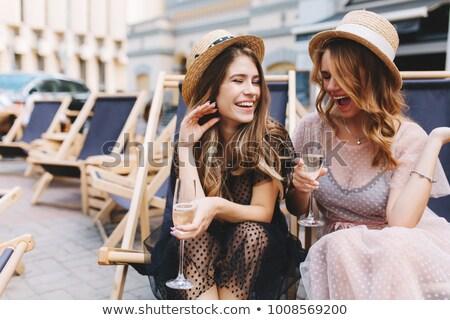 Fiatal szőke nő iszik pezsgő nő ital Stock fotó © photography33