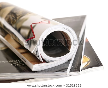 Woman's rolled glossy magazine in stack. isolated with clipping  Stock photo © tolokonov
