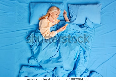 Woman in bed writing on agenda Stock photo © photography33