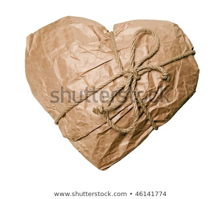 Heart packed in brown paper on white background. Stock photo © Leonardi