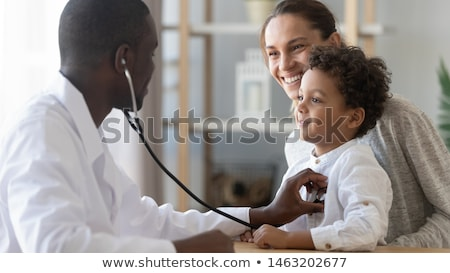 Doctor visits a young caucasian woman with stethoscope Stock photo © ambro