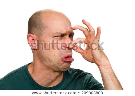man pinches his nose as if something stinks Stock photo © ichiosea