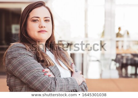 Businesswoman standing in half turn Stock photo © cherezoff