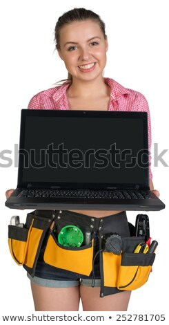 Woman in tool belt, holding opened laptop Stock photo © cherezoff