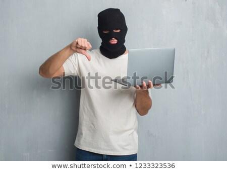 Hacker gesztikulál laptopot használ technológia notebook bűnözés Stock fotó © wavebreak_media