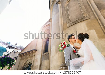 bride with fiance against church Stock photo © Paha_L