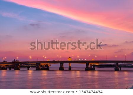 sea at sunset from sarasin bridge stock photo © yongkiet