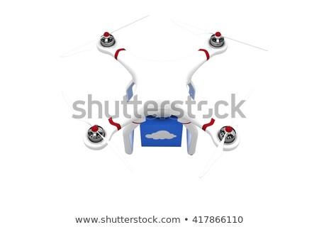 Composite image of a drone bringing a blue cube Stock photo © wavebreak_media