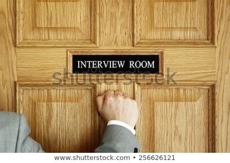 Businessman knocking on interview room door Stock photo © stevanovicigor