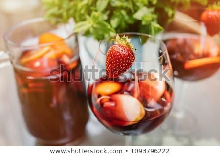 Detox fruit water on wooden table. Fresh homemade lemonade with  Stock photo © Yatsenko