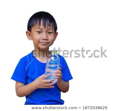 cute · bebé · nino · mentiras · botella · aislado - foto stock © traimak