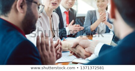 Business team closing a deal Stock photo © IS2