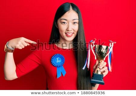 Glimlachend meisje eerste plaats lint winnaar Stockfoto © IS2