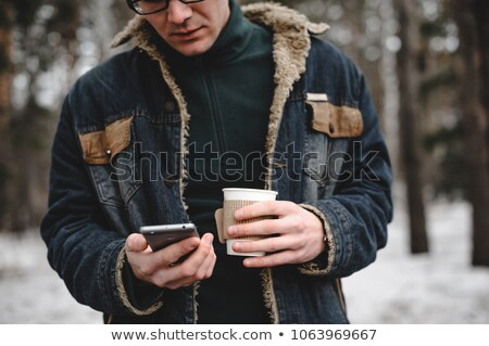 Young man drinking coffee outside Stock photo © lubavnel