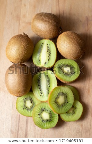 Whole and cut kiwifruit on table  Stock photo © dash