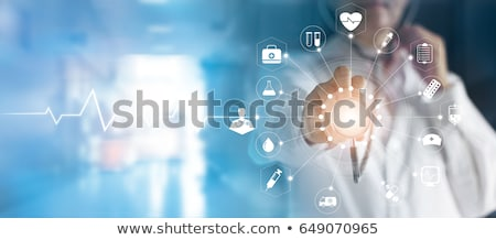 Doctor with medical technology in hospital Stock photo © boggy