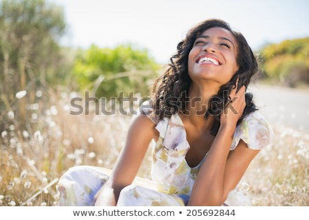 Smiling woman in blue and black dress Stock photo © acidgrey