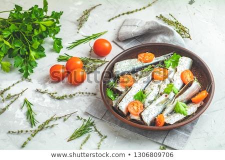 Sardines or baltic herring with rosemary, thyme, parsley,  tomat stock photo © artsvitlyna