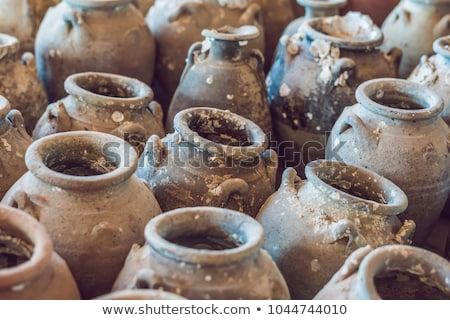 Ancient Vietnamese traditional pots overgrown with seashells Stock photo © galitskaya