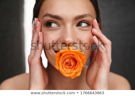Portrait of an excited young topless woman Stock photo © deandrobot