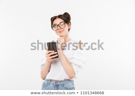 Caucasian woman 20s with double buns hairstyle looking upward wi Stock photo © deandrobot