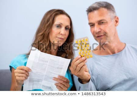 Couple Reading A Leaflet After Taking Pills Stock photo © AndreyPopov