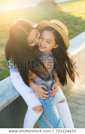 mother and daughter walking together summer cloth stock photo © robuart