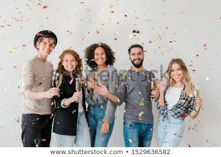 Jovem extático amigos para cima champanhe Foto stock © pressmaster