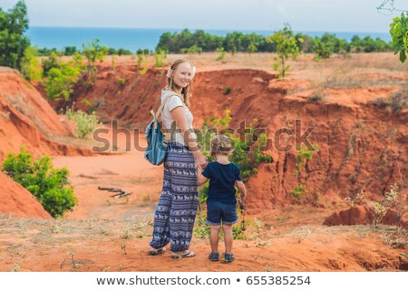 mother and son travelers in red canyon near mui ne southern vietnam traveling with children concep stock photo © galitskaya